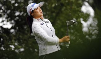 So Yeon Ryu, of South Korea, follows the flight of her ball after playing on the 10th hole during the first round of the Evian Championship women's golf tournament in Evian, eastern France, Thursday, Sept. 14, 2017. (AP Photo/Laurent Cipriani)