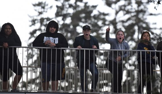Protesters shout from a walkway before a speaking engagement by Ben Shapiro on the campus of the University of California Berkeley in Berkeley, Calif., Thursday, Sept. 14, 2017. Several streets around the University of California, Berkeley, were closed off Thursday with concrete and plastic barriers ahead of an evening appearance by the conservative commentator - the latest polarizing event to raise concerns of violence on the famously liberal campus. (AP Photo/Josh Edelson)