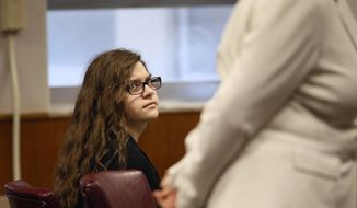 Anissa Weier, left, listens as her attorney Maura McMahon questions a witness Thursday, Sept. 14, 2017, in Waukesha County Court, Waukesha County, Wis.  Prosecutors allege that Weier and her friend, Morgan Geyser, lured classmate Payton Leutner into a Waukesha park in May 2014 and stabbed her 19 times. The girls have said it was an effort to  to please a fictional horror character known as Slender Man.  (Michael Sears//Milwaukee Journal-Sentinel via AP, Pool)