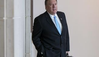 FILE - In this May 16, 2017, file photo, CIA Director Mike Pompeo arrives at the Capitol to brief members of the House Intelligence Committee in the aftermath of President Donald Trump reportedly sharing classified information with two Russian diplomats during a meeting in the Oval Office, in Washington. Pompeo is scheduled to discuss allegations of Russian involvement in last year's presidential election, the nuclear standoff with North Korea and other issues in an appearance at Harvard University on Thursday, Sept. 14. (AP Photo/J. Scott Applewhite, File)