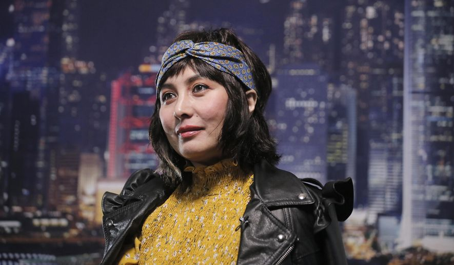 Hong Kong actress and singer Josie Ho talks during an interview in Hong Kong, Tuesday, Sept. 12, 2017. The daughter of the Macau Casino Mogul Stanley Ho, Ho is putting out new music, touring Asia, and shot a new travel segment on TLC. (AP Photo/Vincent Yu)