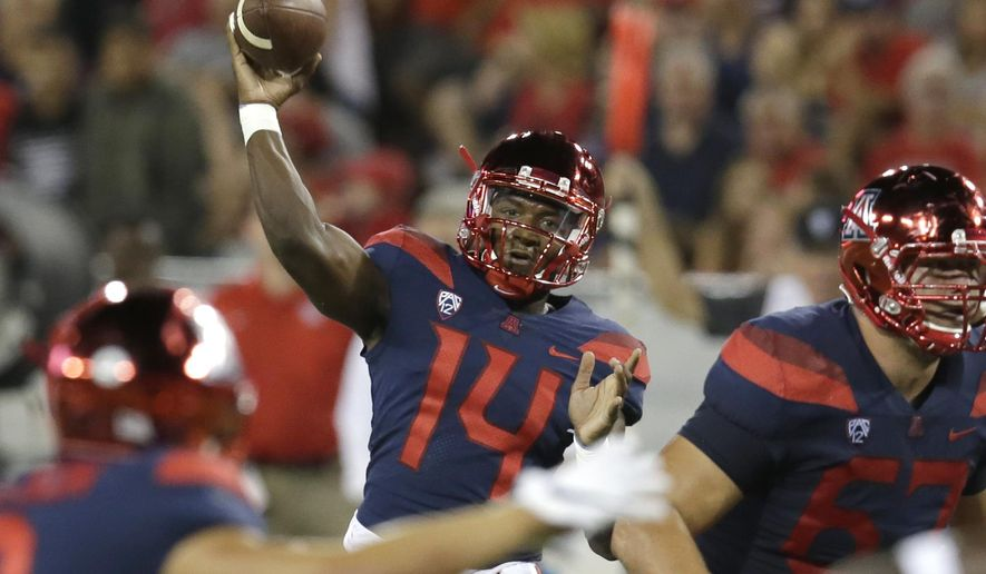 Arizona quarterback Khalil Tate (14) throws against Houston during the second half of an NCAA college football game, Saturday, Sept. 9, 2017, in Tucson, Ariz. Houston defeated Arizona 19-16. (AP Photo/Rick Scuteri)