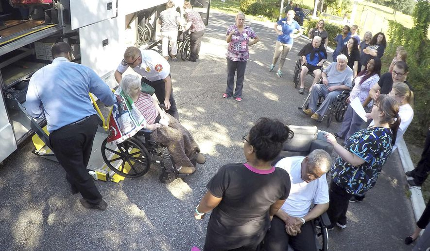 Staff members at Westwood Nursing and Rehabilitation Center in Fort Walton Beach, Fla., and firefighters from Fort Walton Beach Fire Department load Hurricane Irma evacuees, who had stayed at Westwood since last Saturday, onto a bus on Wednesday Sept. 13, 2017 to head back to the their facility in Mayo, Fla. (Nick Tomecek/Northwest Florida Daily News via AP)