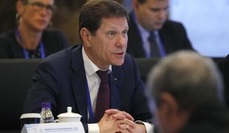 FILE - In this June 13, 2017, file photo, IOC Coordination Commission chairman Alexander Zhukov of Russia speaks during a plenary session of the second IOC Coordination Commission meeting with Beijing Organizing Committee for the 2022 Beijing Winter Olympic Games, at a hotel in Beijing. Zhukov tells The Associated Press he expects all of his country's athletes to be in South Korea for the Winter Olympics. (AP Photo/Andy Wong, File)