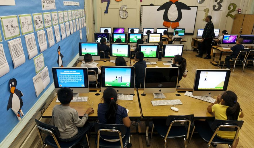 FILE - In this May 15, 2012 file photo, Ritter Elementary School elementary students practice their math skills in Los Angeles. The Los Angeles Unified School District will direct $151 million to 50 schools to settle a lawsuit over how the nation's second-largest school system spends money intended for its neediest students. (AP Photo/Damian Dovarganes, File)