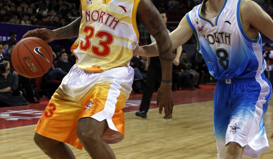 FILE - In this March 21, 2010, file photo, Stephon Marbury of China North team drives the ball down the court against Liu Wei of China South team, during the China Basketball Association's all-star game in Beijing.  Marbury hopes to finish off his basketball career back in the NBA. The 40-year-old guard is playing in the Chinese Basketball Association this season for the Beijing Fly Dragons and then when the league ends in February or March he wants to join an NBA franchise. (AP Photo/Gemunu Amarasinghe, File)