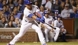 Chicago Cubs' Willson Contreras slaps a two-run single off New York Mets relief pitcher Hansel Robles during the fourth inning of a baseball game Wednesday, Sept. 13, 2017, in Chicago. (AP Photo/Charles Rex Arbogast)