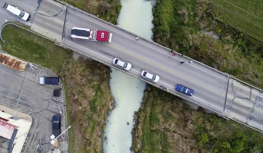 This Sept. 12, 2017 drone photo provided by Tipton County Emergency Management shows an accidental milk spill at a food processing business that ended up turning a central Indiana creek white in Tipton, Ind. The change in the hue of Cicero Creek in Tipton was noticed on Tuesday and investigators determined that no more than 300 gallons of milk spilled at Park 100 Foods. Officials indicate the spill wasn't dangerous. (Tipton County Emergency Management via AP)