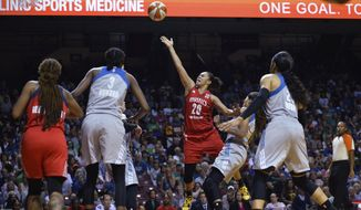 Washington Mystics guard Kristi Toliver (20) shoots and is fouled by Minnesota Lynx guard Seimone Augustus (33) during the second quarter of a WNBA basketball playoff game Thursday, Sept. 14, 2017, in Minneapolis. (Aaron Lavinsky/Star Tribune via AP)