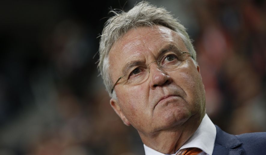 In this Friday Oct. 10, 2014 file photo Netherlands head coach Guus Hiddink watches his players during the Euro 2016 qualifying match between The Netherlands and Kazakhstan at ArenA stadium in Amsterdam, Netherlands. Guus Hiddink says he is willing to become a technical advisor to South Korea's football team at the World Cup next year, but has dismissed rumors that he will again be appointed coach of the team during a press conference in Amsterdam Thursday Sept. 14, 2017. Hiddink has been revered in South Korea ever since he led the team to the semifinals of the World Cup in 2002 when Korea and Japan co-hosted the tournament. (AP Photo/Peter Dejong)