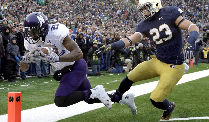 FILE - In this Nov. 15, 2014 file photo, Northwestern wide receiver Kyle Prater (21) catches a touchdown pass against Notre Dame safety Drue Tranquill (23) during the first half of an NCAA college football game in South Bend, Ind.  Consistency is the mantra for Notre Dame safety Tranquill, a mantra which also provides a lofty goal for a team coming off a season plagued by quick starts fizzling to last-minute losses. (AP Photo/Nam Y. Huh, File)