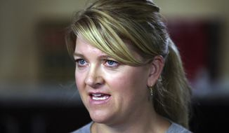 FILE--In this Sept. 1, 2017, file photo, nurse Alex Wubbels speaks during an interview after she was dragged in handcuffs by Utah police from a hospital in Salt Lake City. The case of the police officer caught on video dragging Wubbels from the hospital in handcuffs is now before a Utah police chief to decide possible punishment after a law enforcement oversight board found the detective lost control and got aggressive while his supervisor failed to seek legal advice that could have calmed the situation. (AP Photo/Rick Bowmer, file)
