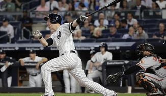 New York Yankees' Todd Frazier follows through on a three-run home run during the first inning of a baseball game against the Baltimore Orioles on Thursday, Sept. 14, 2017, in New York. (AP Photo/Frank Franklin II)