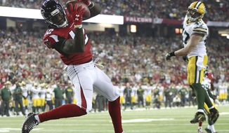 FILe - In this Oct. 30, 2016, file photo, Atlanta Falcons wide receiver Mohamed Sanu catches a touchdown pass from Matt Ryan past Green Bay Packers defender Jake Ryan for a 33-32 victory in an NFL football game in Atlanta. When the Falcons host the Packers on Sunday night, it will be both an early indicator of the NFC's balance of power as well as the third meeting between the teams in less than 11 months. All three of those games have been in Atlanta, though this one will be at a new venue. The Falcons (1-0) are making the regular-season debut at $1.5 billion Mercedes-Benz Stadium, which replaced the Georgia Dome. (Curtis Compton/Atlanta-Journal Constitution via AP, File)