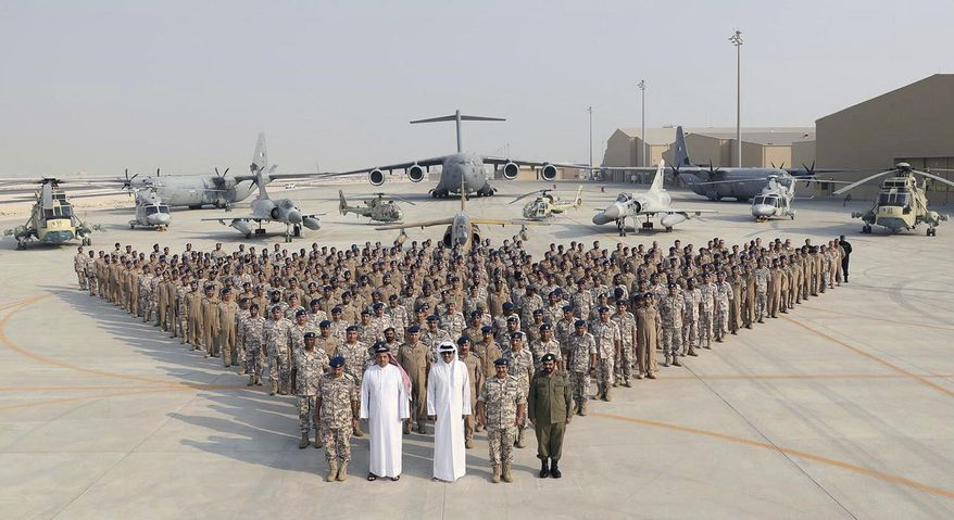Qatari Emir Sheikh Tamim bin Hamad Al Thani made a special Sept. 11 visit to the Al Udeid Air Base to pose with personnel from the Qatar's Emir Air Force. Then the Emir also met with American commanders at the base, which is home to the forward headquarters of the U.S. military's Central Command. (Associated Press/File)
