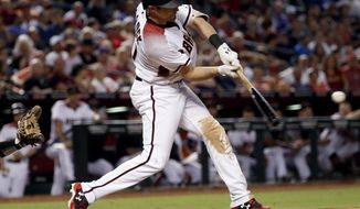 Arizona Diamondbacks' A.J. Pollock connects for a three-run home run against the Colorado Rockies during the seventh inning of a baseball game, Wednesday, Sept. 13, 2017, in Phoenix. (AP Photo/Matt York)