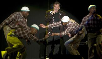 "In this photo taken Saturday, July 2017, South African musician Johnny Clegg, middle, and the dancers perform during ""The Final Journey"" concert at the Grand Arena in Cape Town, South Africa. Clegg, who has had chemotherapy and other treatment for pancreatic cancer, says he feels ""fit and strong"" as he begins his last international tour. (AP Photo)"