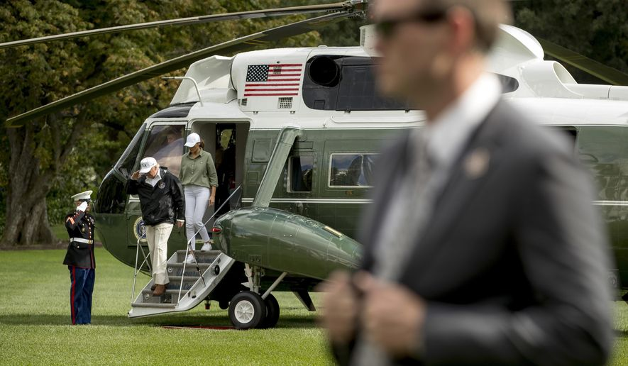 President Donald Trump and first lady Melania Trump arrive at the White House in Washington, Thursday, Sept. 14, 2017, after meeting with people impacted by Hurricane Irma in Florida. (AP Photo/Andrew Harnik)