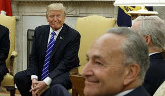In this Sept. 6, 2017 file photo, President Donald Trump and Senate Minority Leader Chuck Schumer, D-N.Y., during a meeting with  other Congressional leaders in the Oval Office of the White House in Washington.  Mr. Trump on Nov. 28 blasted Mr. Schumer and his House counterpart Nancy Pelosi for failing to show at a meeting on tax reform. (AP Photo/Evan Vucci) **FILE**
