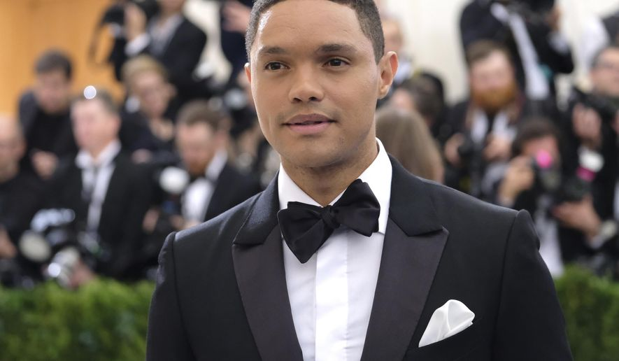 "FILE - In this May 1, 2017 file photo, Trevor Noah attends The Metropolitan Museum of Art's Costume Institute benefit gala in New York. Comedy Central says it has agreed to a contract extension that will keep Trevor Noah as host of ""The Daily Show"" through 2022. (Photo by Charles Sykes/Invision/AP, File)"