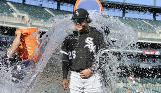 Chicago White Sox right fielder Avisail Garcia (26) is doused with water by first baseman Jose Abreu (79) as second baseman Yolmer Sanchez (5) prepares to douse him again after defeating the Detroit Tigers 17-7 in a baseball game, Thursday, Sept. 14, 2017, in Detroit. (AP Photo/Jose Juarez)