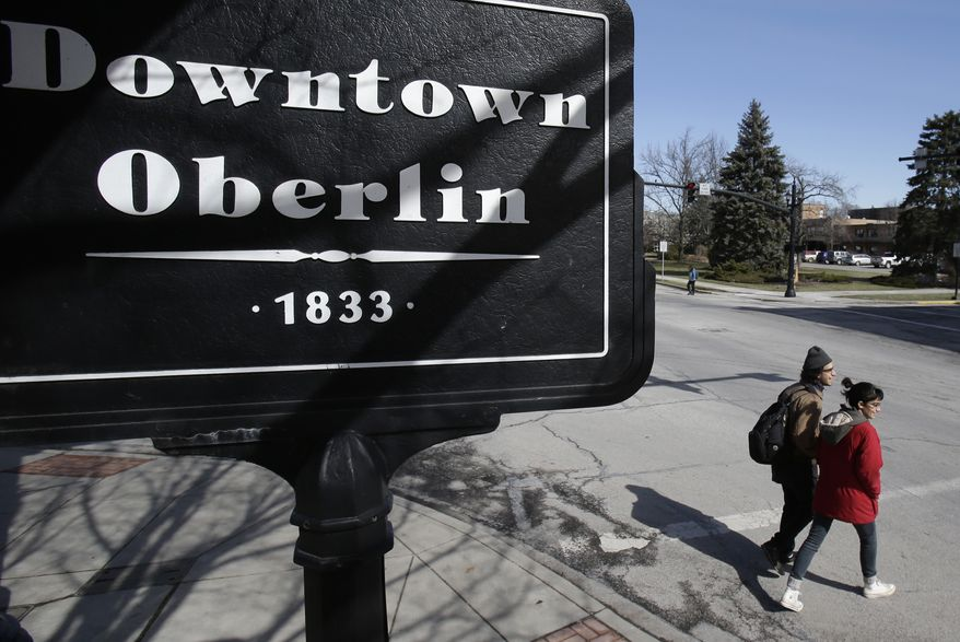 Students walk in downtown Oberlin on March 5, 2013 in this file photo. (Associated Press) **FILE**