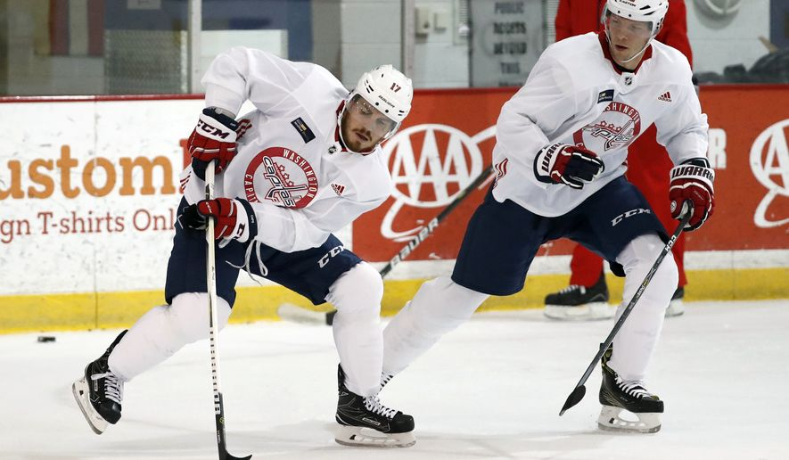 Washington Capitals' Chris Bourque, left, works against Alex Chiasson during practice at their NHL hockey practice facility, Friday, Sept. 15, 2017 in Arlington, Va. (AP Photo/Alex Brandon)