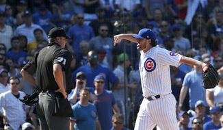 Chicago Cubs starting pitcher John Lackey, right, yells at home plate umpire Jordan Baker during the fifth inning of a baseball game against the St. Louis Cardinals Friday, Sept. 15, 2017, in Chicago. Baker threw Lacket out of the game. (AP Photo/Charles Rex Arbogast)