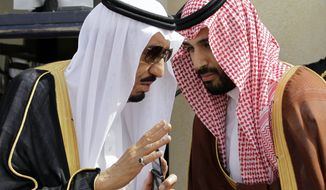 FILE - In this May 14, 2012 file photo, King Salman, left, speaks with his son, now Crown Prince Mohammed Bin Salman, as they wait for Gulf Arab leaders ahead of the opening of Gulf Cooperation Council, in Riyadh, Saudi Arabia. The arrests of apparent Islamist sympathizers and critics of the crown prince have thrown an already anxious kingdom into deep unease, raising questions about the country's steadiness as speculation mounts that the crown prince, also known as MBS, could soon replace his father as king. (AP Photo/Hassan Ammar, File)
