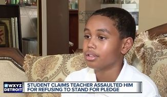 "A teacher at East Middle School in Farmington Hills, Michigan, is on administrative leave after she was accused of ""violently"" snatching 6th-grader Stone Chaney (pictured here) out of his seat because he refused to stand for the Pledge of Allegiance. (WXYZ)"