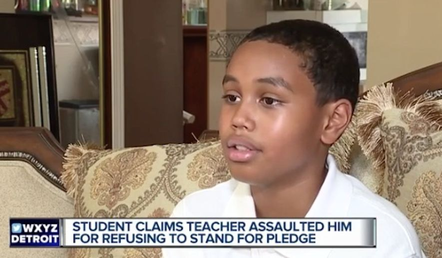 """A teacher at East Middle School in Farmington Hills, Michigan, is on administrative leave after she was accused of """"violently"""" snatching 6th-grader Stone Chaney (pictured here) out of his seat because he refused to stand for the Pledge of Allegiance. (WXYZ)"""
