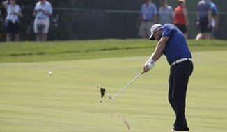Marc Leishman hits his second shot on the third hole during the second round of the BMW Championship golf tournament at Conway Farms Golf Club, Friday, Sept. 15, 2017, in Lake Forest, Ill. (AP Photo/Nam Y. Huh)