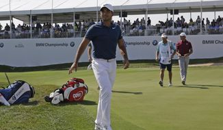 Jason Day leaves the 18th hole during the second round of the BMW Championship golf tournament at Conway Farms Golf Club, Friday, Sept. 15, 2017, in Lake Forest, Ill. (AP Photo/Nam Y. Huh)