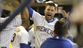 Milwaukee Brewers' Neil Walker celebrates his grand slam during the eighth inning of a baseball game against the Miami Marlins Friday, Sept. 15, 2017, in Milwaukee. (AP Photo/Morry Gash)