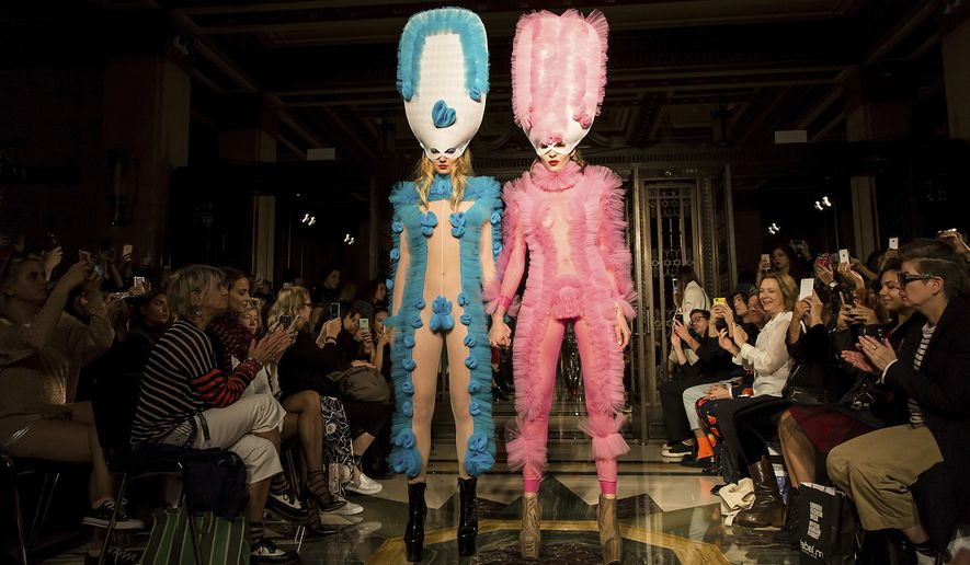 Models wears creations by designer Pam Hogg during their Spring/Summer 2018 runway show at London Fashion Week in London, Friday, Sept. 15, 2017. (Photo by Grant Pollard/Invision/AP)