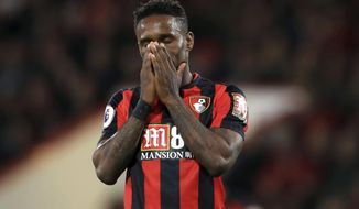 Bournemouth's Jermain Defoe reacts after a missed chance during the English Premier League soccer match between Bournemouth and Brighton, at the Vitality Stadium, in Bournemouth, England, Friday, Sept. 15, 2017. (John Walton/PA via AP)