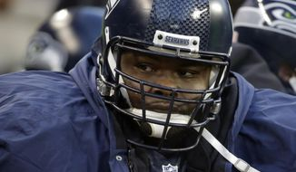 FILE - In this Nov. 29, 2015, file photo, Seattle Seahawks defensive tackle Ahtyba Rubin sits on the bench during an NFL football game against the Pittsburgh Steelers in Seattle. A person with knowledge of the negotiations tells The Associated Press the Denver Broncos are finalizing a one-year deal with Rubin because defensive end Jared Crick is facing possible back surgery.  The person spoke to The AP on condition of anonymity Friday, Sept. 15, 2017, because the team hadn't announced the move, which was first reported by FOX and the NFL Network.(AP Photo/Ted S. Warren, File)