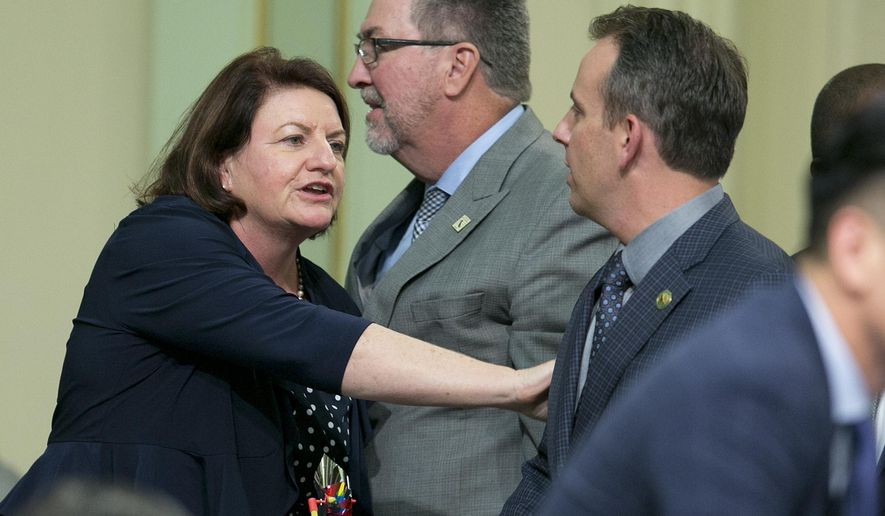 State Sen. Toni Atkins, D-San Diego, thanks Assemblyman Marc Levine, D-San Rafael, after he voted for her housing measure before the state Assembly, Thursday, Sept. 14, 2017, in Sacramento, Calif. Six bills aimed at addressing the crisis cleared the Assembly late Thursday after months of negotiations and cajoling. The bills all need Senate approval on Friday. (AP Photo/Rich Pedroncelli)