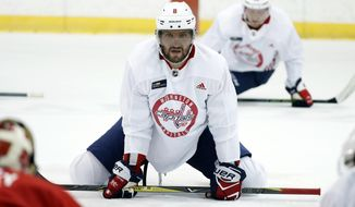 Washington Capitals captain and left wing Alex Ovechkin, from Russia, stretches during practice at their NHL hockey practice facility, Friday, Sept. 15, 2017 in Arlington, Va. (AP Photo/Alex Brandon)