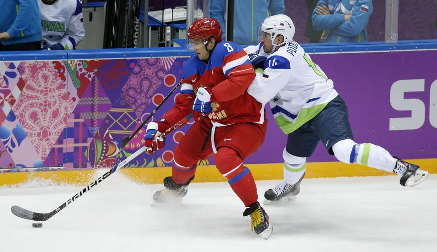 FILE - In this Feb. 13, 2014, file photo, Russia forward Alex Ovechkin, left, keeps the puck from Sovenia defenseman Matic Podlipnik during a men's ice hockey game at the Winter Olympics in Sochi, Russia. Washington Capitals star Ovechkin released a statement Thursday night, Sept. 14, 2017, through the NHL team expressing frustration about the league's decision to skip the Olympics. (AP Photo/Mark Humphrey, File)