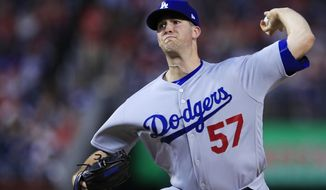 Los Angeles Dodgers starting pitcher Alex Wood (57) throws during the first inning of a baseball game against the Washington Nationals in Washington, Friday, Sept. 15, 2017. (AP Photo/Manuel Balce Ceneta)