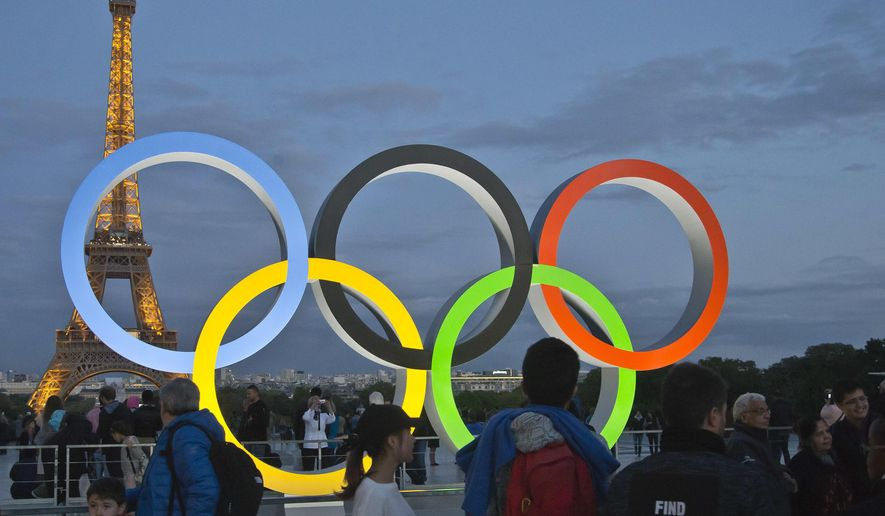 The Olympic rings are set up on Trocadero plaza that overlooks the Eiffel Tower, a day after the official announcement that the 2024 Summer Olympic Games will be in the French capital, in Paris, France, Thursday, Sept. 14, 2017. Paris will host the 2024 Summer Olympics and Los Angeles will stage the 2028 Games. (AP Photo//Michel Euler)