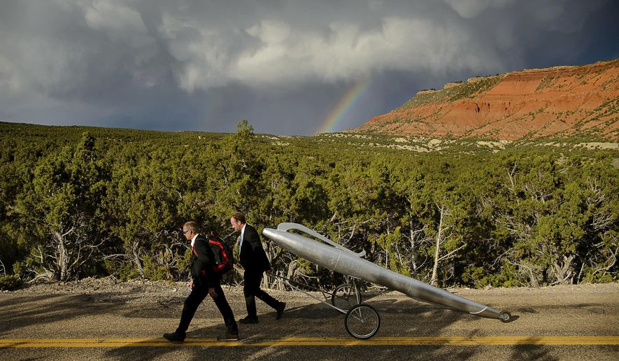 German artists Wolfgang Aichner and Thomas Huber pull a giant replica of a pen on the first day of their art project, Linear, about ten miles northwest of Vernal, Utah, Wednesday, Sept. 13, 2017. The two are launching a four-week performance art project in which they are filming themselves dragging the oversized pen along a 250-mile rectangle through the deserts of Utah, Wyoming and Colorado. (Trent Nelson/The Salt Lake Tribune via AP)