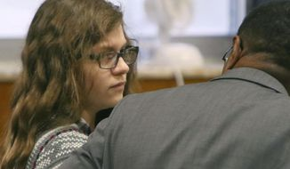 Anissa Weier listens to defense attorney Joseph Smith Jr. during closing arguments in her case before Waukesha County Circuit Court Judge Michael Bohren on Friday, Sept. 15, 2017, in Waukesha, Wis. Weier is accused of helping her friend stab their classmate nearly to death to please online horror character Slender Man. (C.T. Kruger /Milwaukee Journal-Sentinel via AP, Pool)
