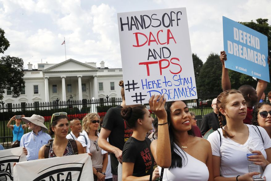 In this Sept. 5, 2017, file photo, Yurexi Quinones, 24, of Manassas, Va., a college student who is studying social work and a recipient of Deferred Action for Childhood Arrivals, known as DACA, rallies next to Ana Rice, 18, of Manassas, Va., far right, in support of DACA, outside of the White House in Washington. (AP Photo/Jacquelyn Martin, File)