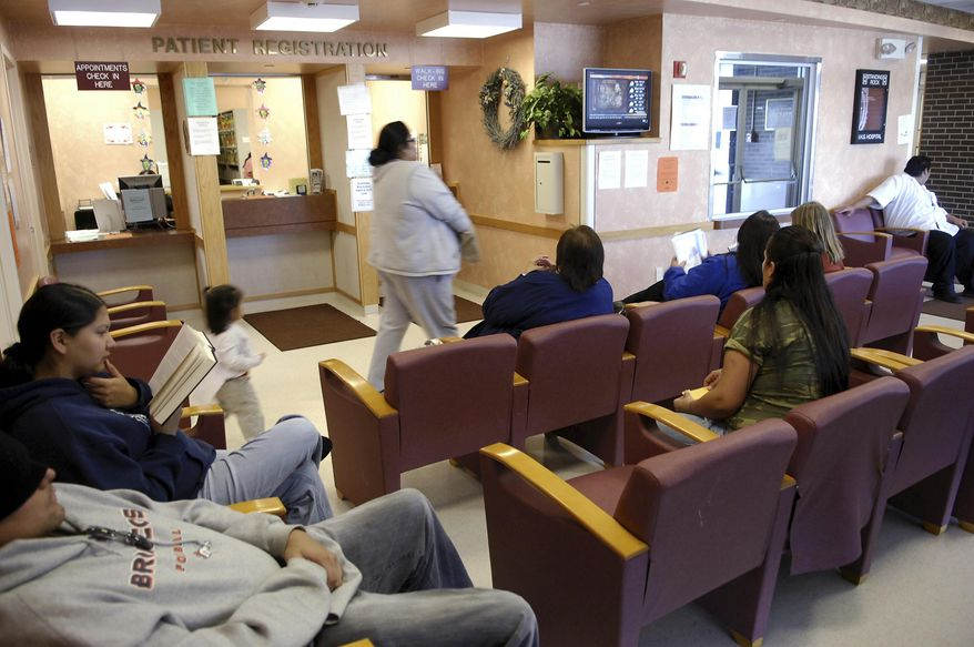 FILE - In this file photo taken Oct. 14, 2008, people sit in the Indian Health Services waiting room on Standing Rock Reservation in Fort Yates. N.D. The Indian Health Service has set standards for patient wait times more than a year after being criticized by a government watchdog for doing a poor job tracking them. (AP Photo/Will Kincaid,File)