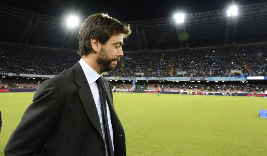"""FILE - In this Sept. 26, 2015 file photo, Juventus President Andrea Agnelli arrives for a Serie A soccer match between Napoli and Juventus, at the San Paolo stadium in Naples, Italy. Agnelli is facing a possible ban over an allegedly illicit relationship with hard-core """"ultra"""" fans that encouraged ticket scalping. The Italian football federation is expected to make a ruling in the case late Friday, Sept. 15, 2017, 10 days after Agnelli was elected to chair the 220-member European Club Association. (AP Photo/Salvatore Laporta, files)"""