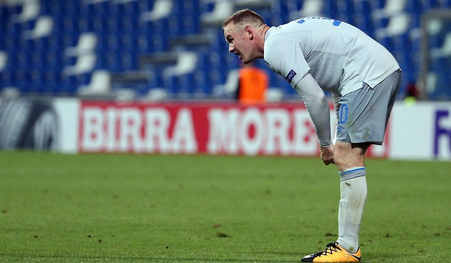 Everton's Wayne Rooney  reacts during the Uefa Europa League soccer match between Atalanta and Everton, at the Mapei Stadium in Reggio Emilia, Italy, Thursday, Sept. 14, 2017.  (Elisabetta Baracchi/ANSA via AP)