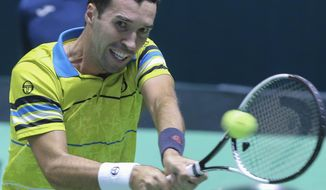 Kazakhstan's Mikhail Kukushkin returns a shot to Argentina's Guido Pella during their a Davis Cup play-off tennis match in Astana, Kazakhstan, on Friday, Sept. 15, 2017. (AP Photo/Stas Filippov)