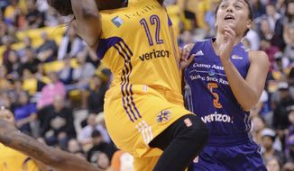 Los Angeles Sparks' Chelsea Gray (12) drives to the basket against Phoenix Mercury's Leilani Mitchell (5) during the first half of Game 2 of WNBA basketball playoff semifinal, Thursday, Sept. 14, 2017, in Long Beach, Calif. (Stephen Carr//Los Angeles Daily News via AP)